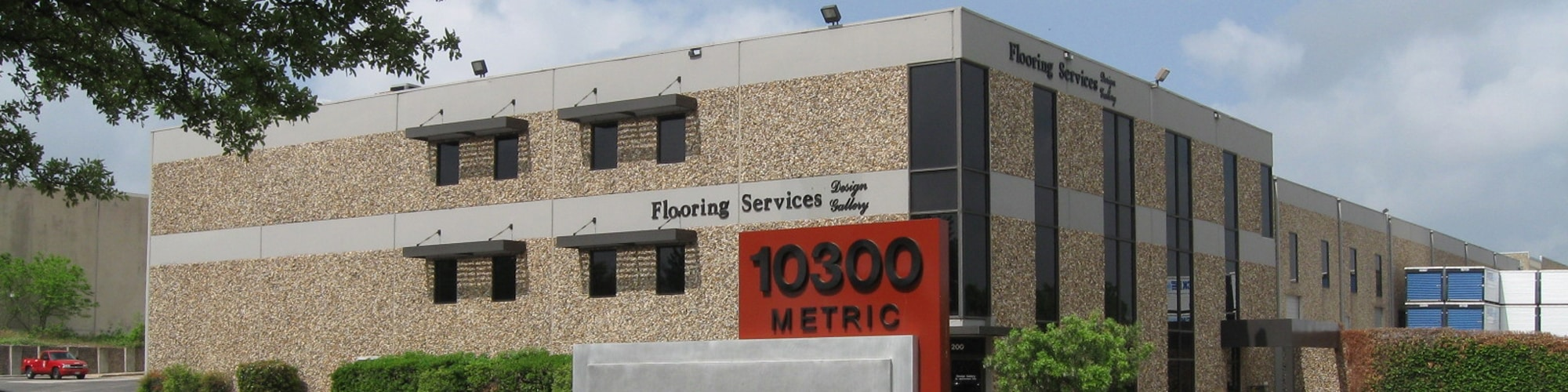 Metric Commerce Center Building and Sign | 10300 Metric Boulevard in Austin, Texas