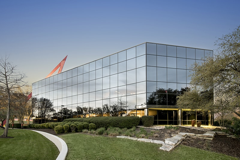 An exterior photo of the Westech 360 building in Austin at twilight | Professional Property Photography by Scott Mason