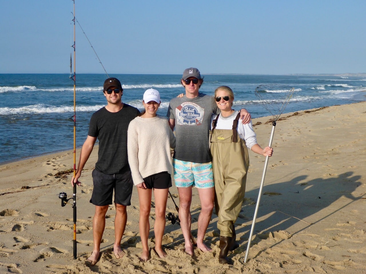 Ben Tolson in Martha's Vineyard fishing with his wife Katie Tolson and friends.