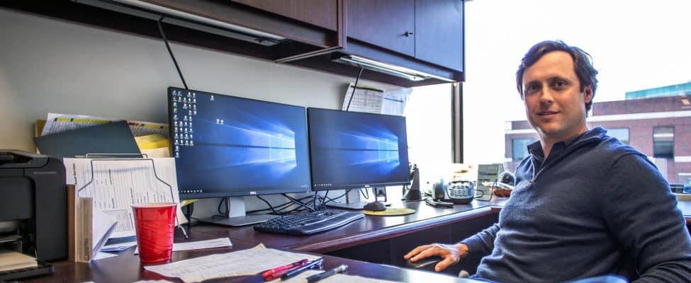 Ben Tolson at his desk at AQUILA