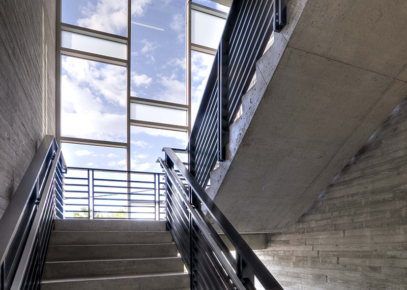 Widened Stairs Required to Accommodate Dense Office Space