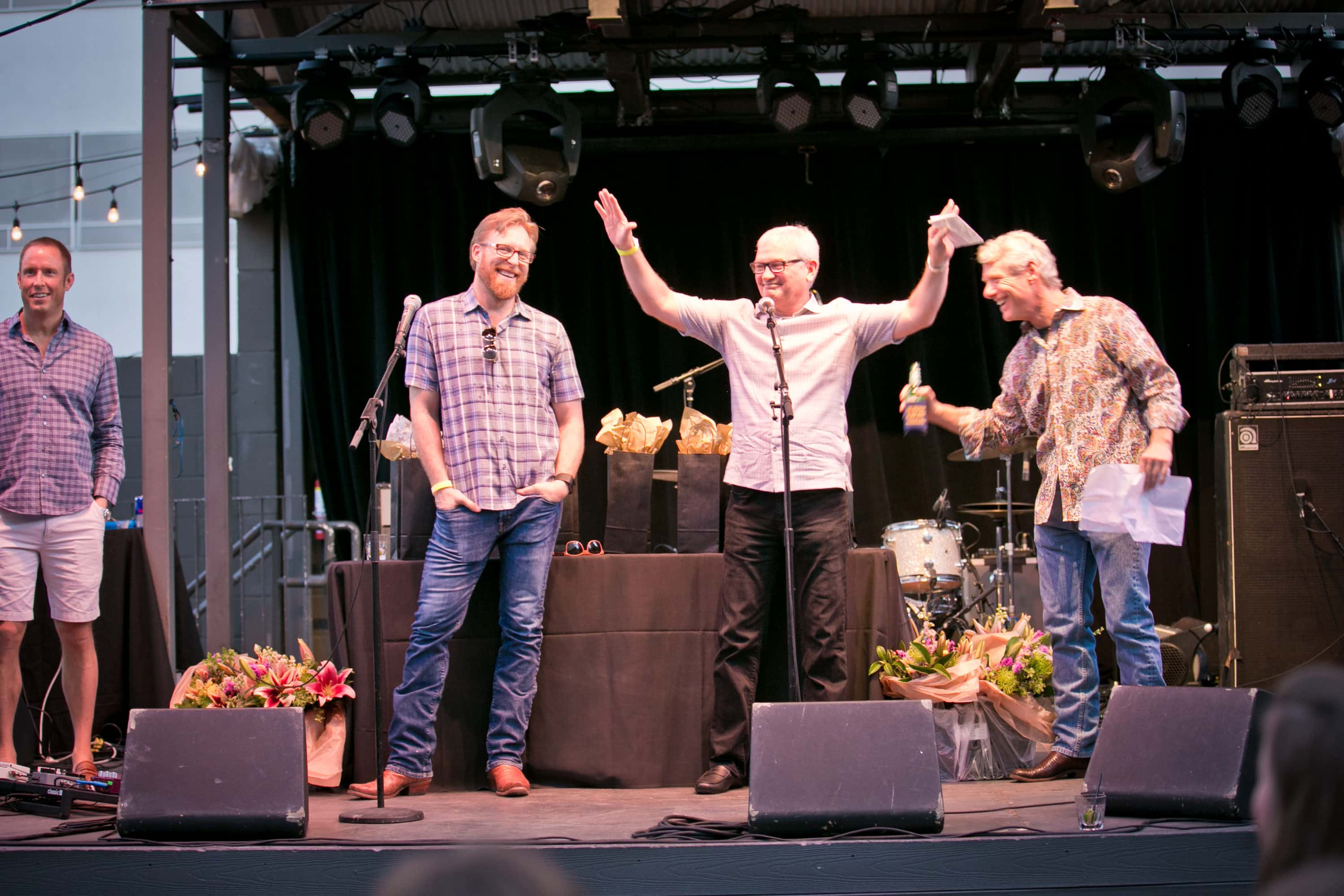 Mike onstage with co-founders Chad Barrett, Jay Lamy and Bart Matheney at AQUILA's 10th Anniversary party in April 2017.
