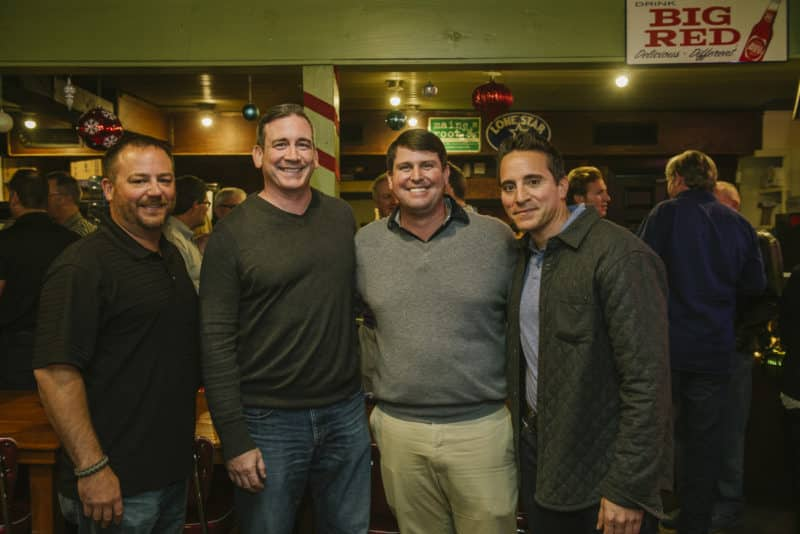 Leigh with AQUILA principal Todd Tebbe and clients Michael Hanley and Scott Dean (SteelSentry) at a client event at Franklin Barbecue.