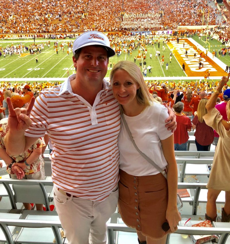 Leigh and wife Lauren at a UT game